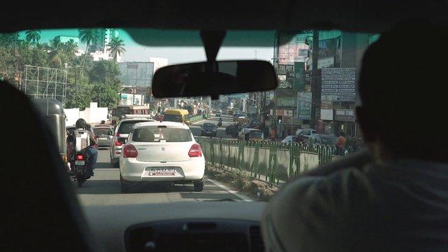 Man Driving Car In Traffic In Trivandrum India thumbnail