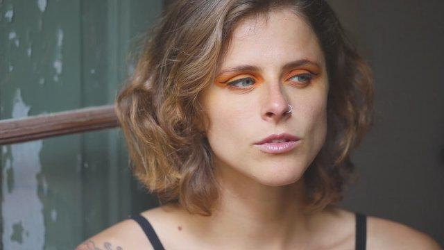 Girl with Orange Eye Makeup thumbnail