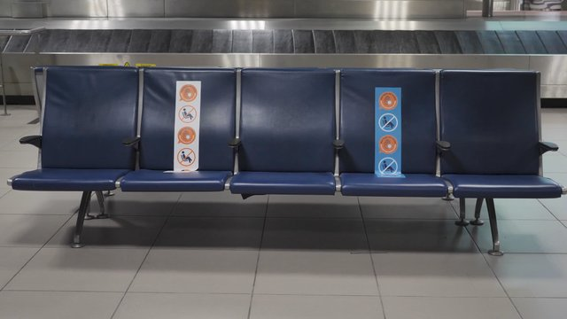 Passenger Woman Comes and Sits on the Bench at the Terminal Lounge thumbnail