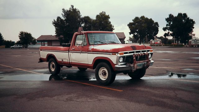 Classic Ford in Parking Lot thumbnail