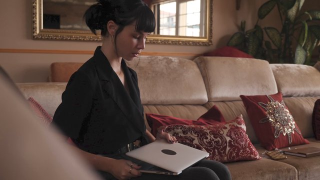 A Girl Opens a Laptop and Starts to Work  thumbnail