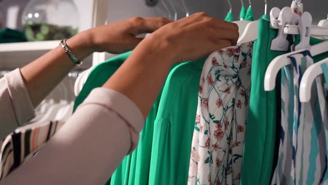 Browsing Clothes on Rack thumbnail