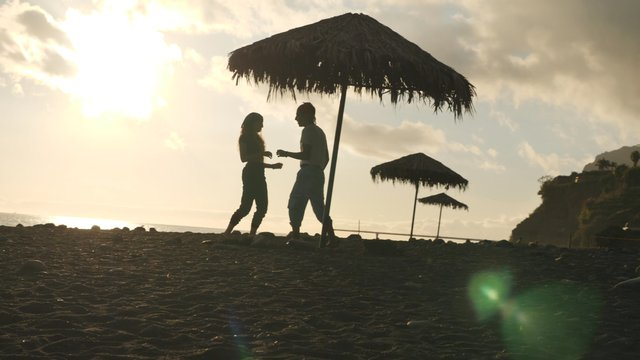 A Couple Have Fun on the Seashore thumbnail