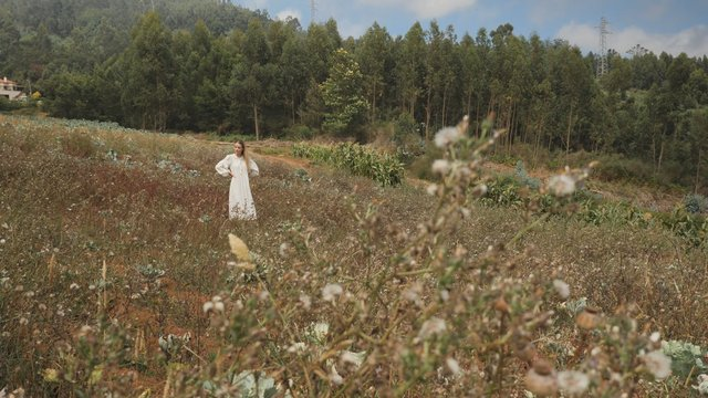 Charming Girl Stands in the Glade thumbnail