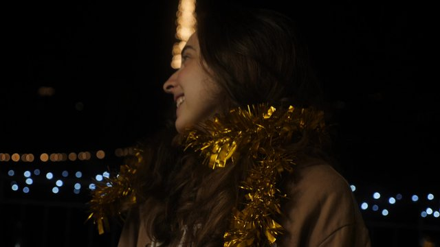 Girl With Golden New Year's Rain on Her Neck thumbnail