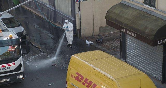 Man Disinfecting Street In Paris thumbnail