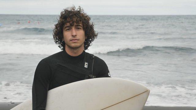 Surfer Boy on a Cloudy Beach  thumbnail
