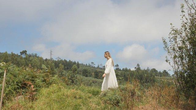 Blonde Girl Walks in the Green Field thumbnail