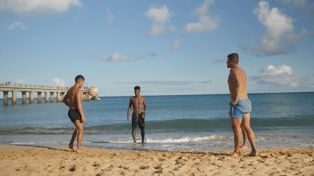 Beach Guys Play a Football thumbnail