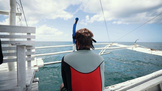 Diver on Boat thumbnail