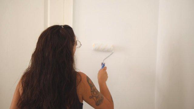 Girl Painting White Walls  thumbnail