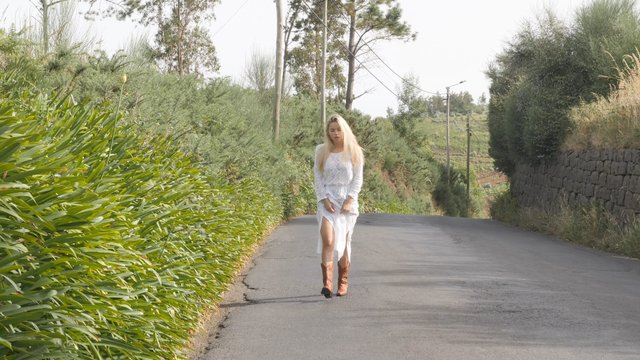 Blonde Girl Walking on the Street with Cowboy Boots  thumbnail