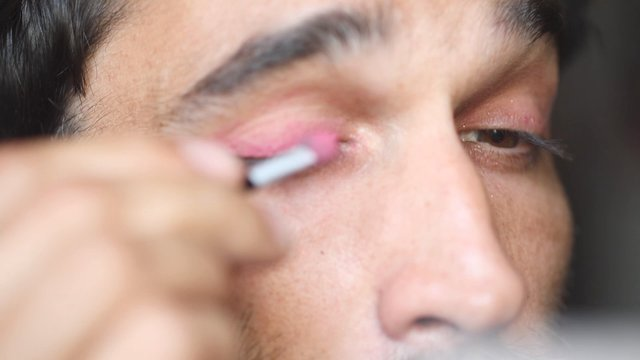 Guy Applying Pink Eyeshadow thumbnail