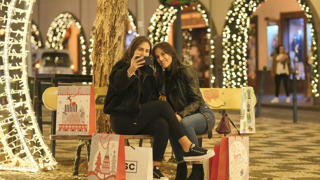 Girls Make Selfie in a Very Illuminated Square thumbnail