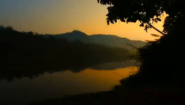 Sun rise at Thattekad Pool view of Athirampilly waterfalls