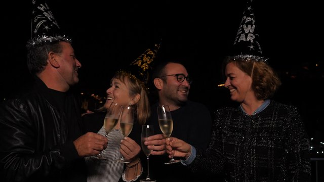 Two Adult Couples Toast With Champagne thumbnail