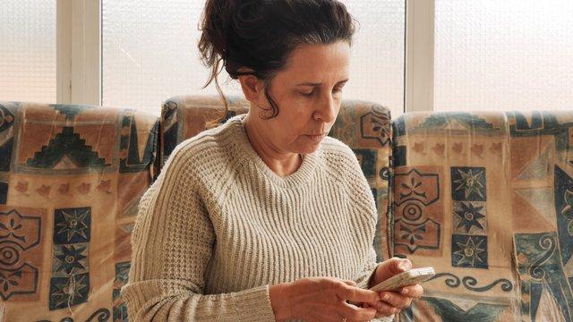 Woman Checking Bills And Money thumbnail