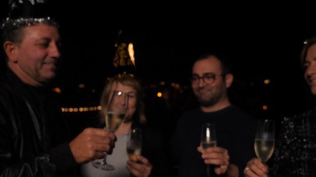 Friends Raise a Toast for the New Year Celebration thumbnail