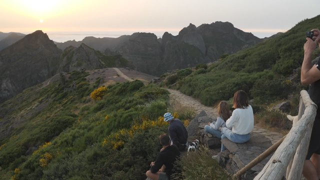 Friends Watching the Sunset on Mountain Top thumbnail