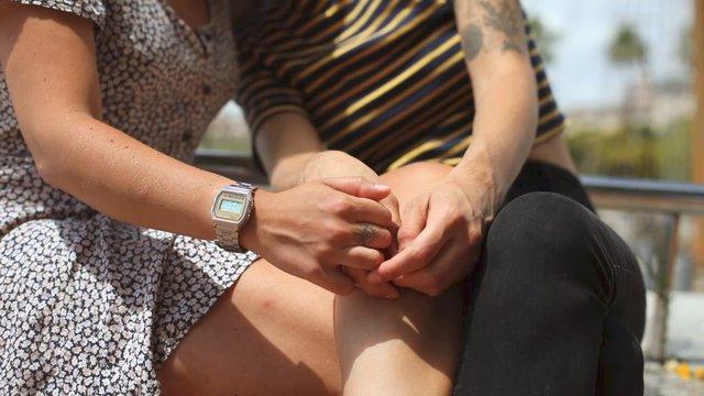 Girlfriends Talking & Holding Hands thumbnail