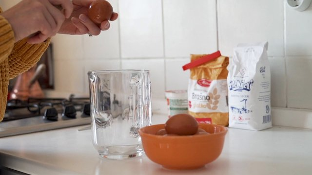 Cracking Eggs into Glass Cup thumbnail
