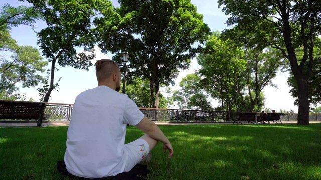 Man Doing Yoga in Park thumbnail