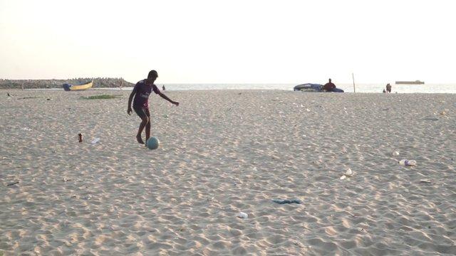 Boys Playing Football At The Beach At Sunset In Kerala thumbnail