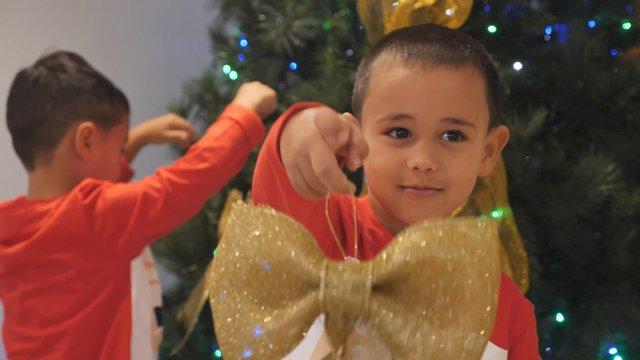 Happy Boy Holds Golden Ribbon Bow  thumbnail