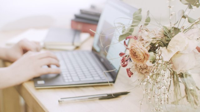 Working On Laptop On Floral Decorated Desk  thumbnail