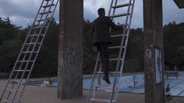A Man Climbs up a Ladder thumbnail