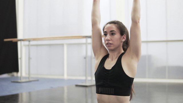 Athletic Woman Stretching Her Body thumbnail
