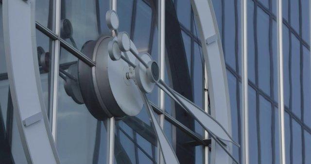 Clock on Glass Building thumbnail