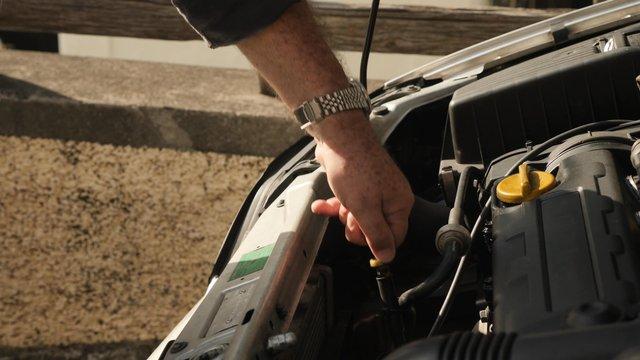 A Senior Man Checks the Oil Level thumbnail