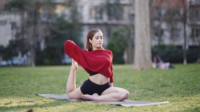 Girl Stretching Legs Outdoors  thumbnail