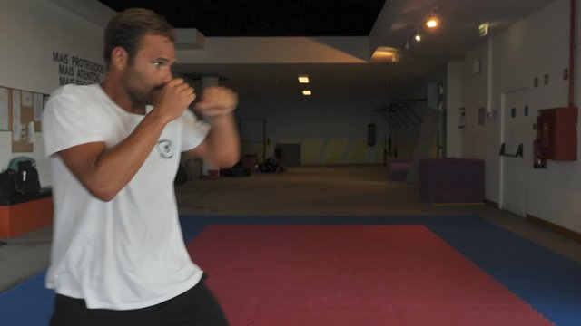 Young Man Practices a Punch thumbnail