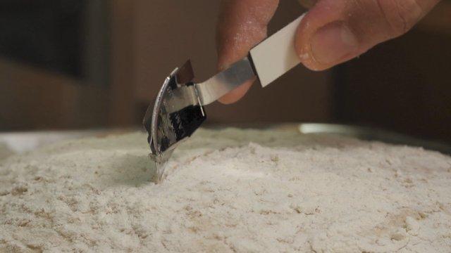 Chef Scoring a Sourdough thumbnail