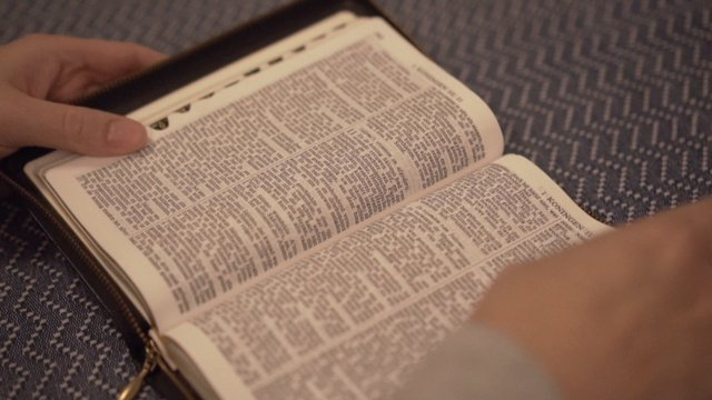 Flipping Through Pages Of A Bible  thumbnail