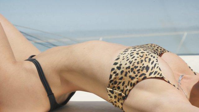 Blonde Girl Sunbathing thumbnail