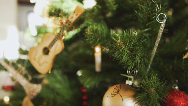 A Guitar Ornament on a Christmas Tree thumbnail