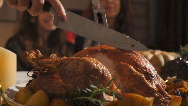 A Man Cuts a Roasted Turkey  thumbnail