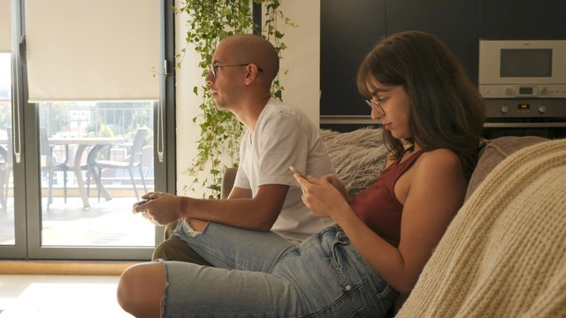 A Couple Spends Leisure Time Indoors thumbnail