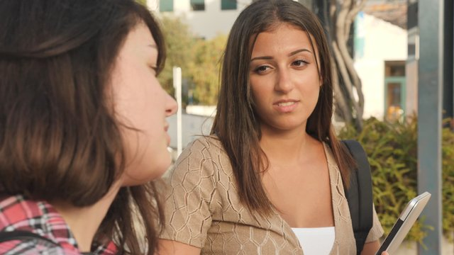 College Friends Talking in Bus Stop thumbnail