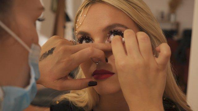 Makeup Artist Adjusts a Makeup thumbnail