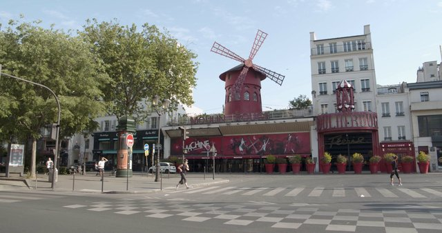 People Jogging Near Moulin Rouge thumbnail