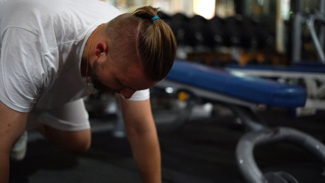 Man Trains In The Gym thumbnail
