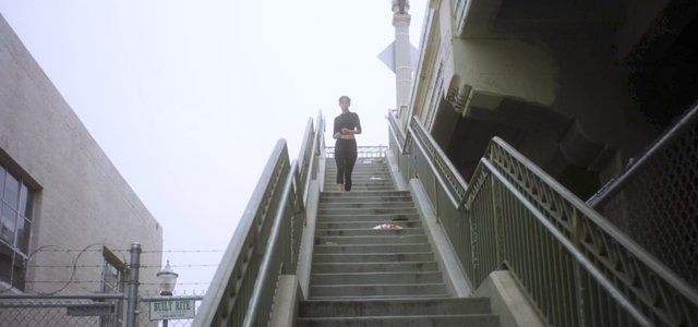 Girl Runnning Down the Stairs Bottom View thumbnail