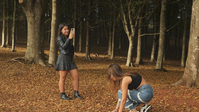 Girls Film a Video in Autumn Forest thumbnail