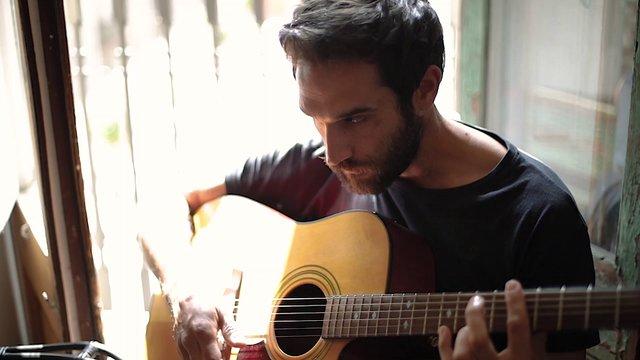 Man Playing Guitar  thumbnail