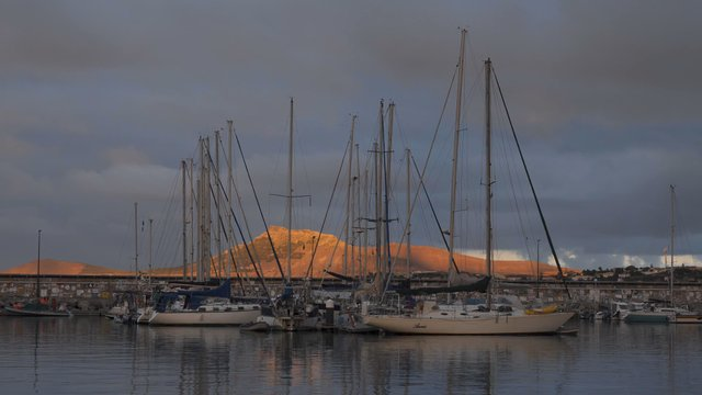 Static Shot of Yachts on a Port at Evening thumbnail