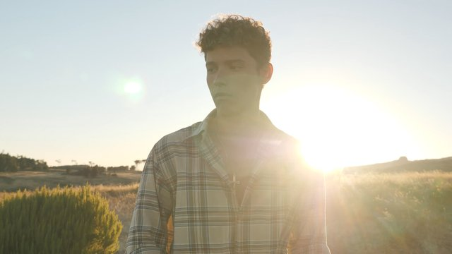 Serious Curly Guy Poses in the Field thumbnail